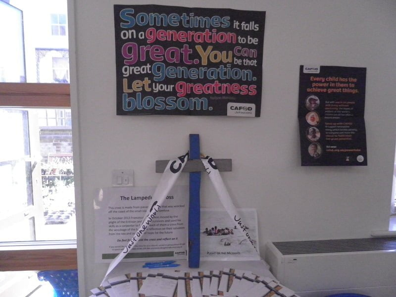 A picture of an altar with CAFOD posters and decorations