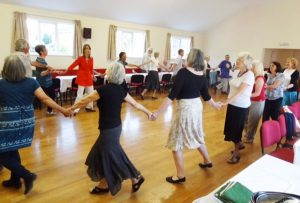 People dancing in a church hall